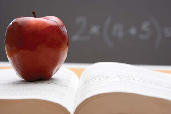 Image of apple on textbook